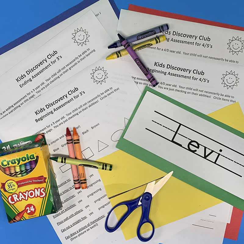 Freebie Assessment showing various worksheets, crayons, and scissors.